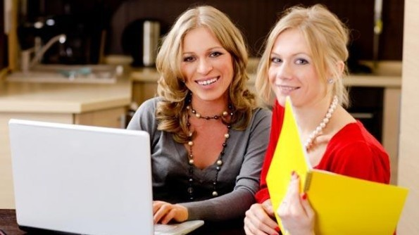 Young women using laptop computer for small business
