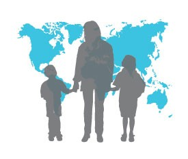 Silhouette of family in front of world map