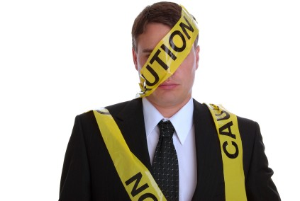 Man with caution tape wrapped around him