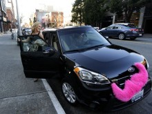 SUV with a pink furry mustache