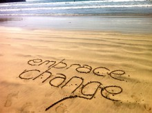 Embrace Change written in the sand at a beach